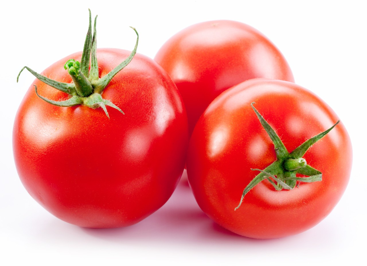 Ripe red tomatoes isolated on a white background.